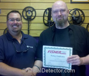 One of the MetalDetector.com team members Thom receiving his Fisher Metal Detectors certified training certificate by Mike Scott.