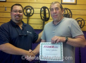 Product Specialist Moe awarded certified training certificate by Mike Scott from Fisher Metal Detectors.