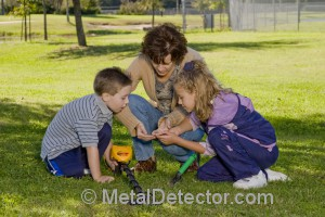 Treasure hunting with a metal detector is a fun family activity.