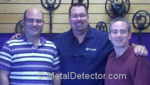 Dig Wars team member Mike Scott with Daniel and Michael Bernzweig of MetalDetector.com