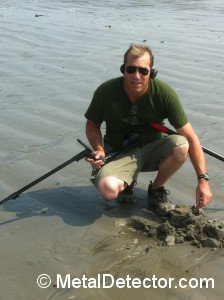 Fresh water metal detecting at the shoreline.